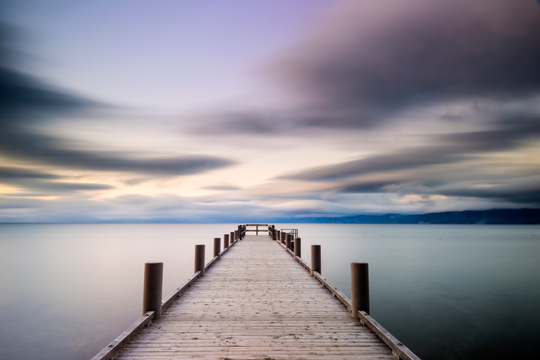 Evening Light Over A Pier In Lake Tahoe, California