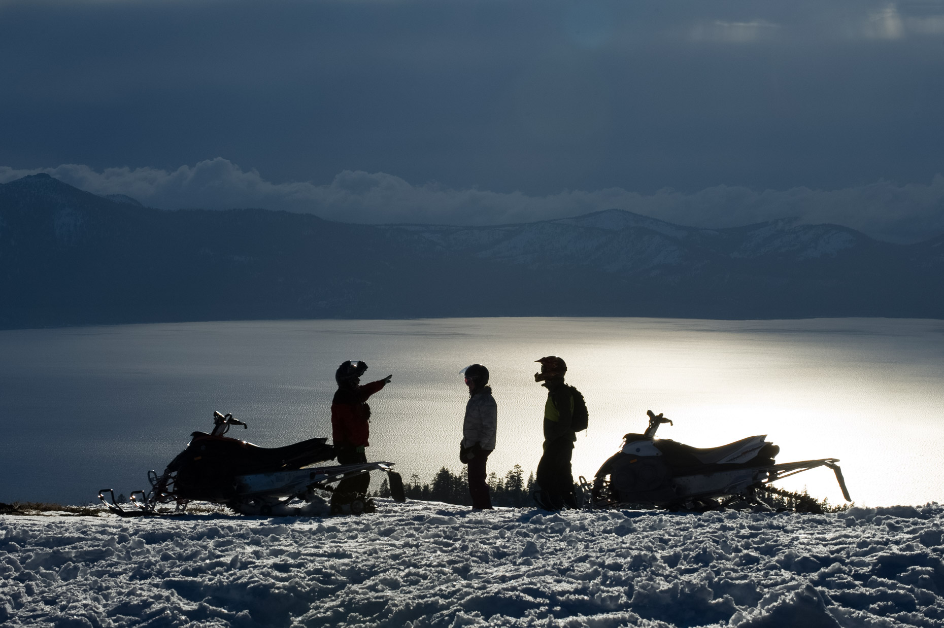 Snowmobiling At Sunset - Lake Tahoe
